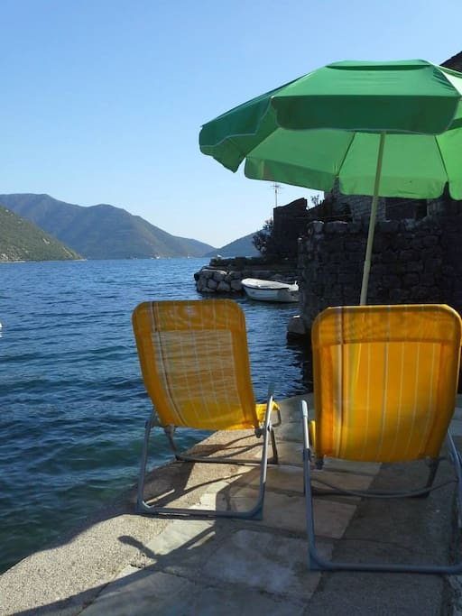 Great place to relax, watch cruise ships, enjoy the sunset and view on the two islands of Perast.