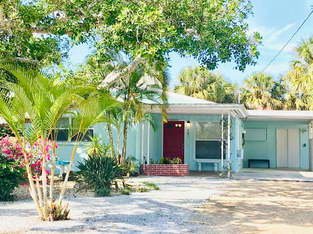 Welcome to our Cozy Cottage on Siesta Key! Classic Florida bungalow on a quiet street about 4 blocks to siesta village.