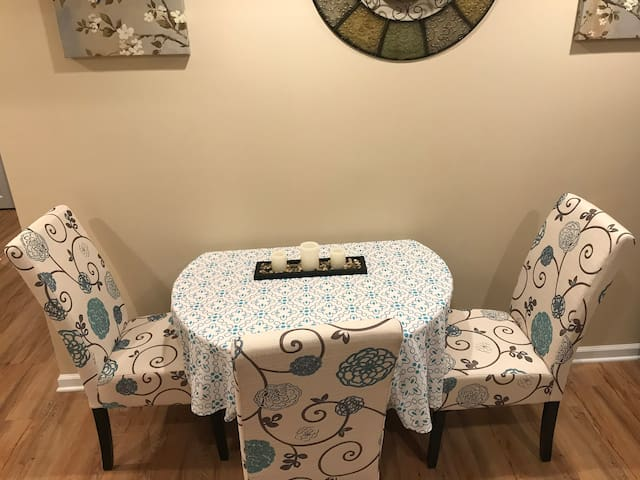 Drop leaf table with room for 4  (3 chairs here and one in the large bedroom.)