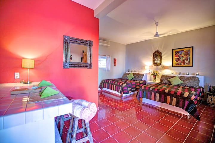 Two Queen sized beds for up to 4 guests, with ocean views, terrace, bathroom and fully equipped kitchen.