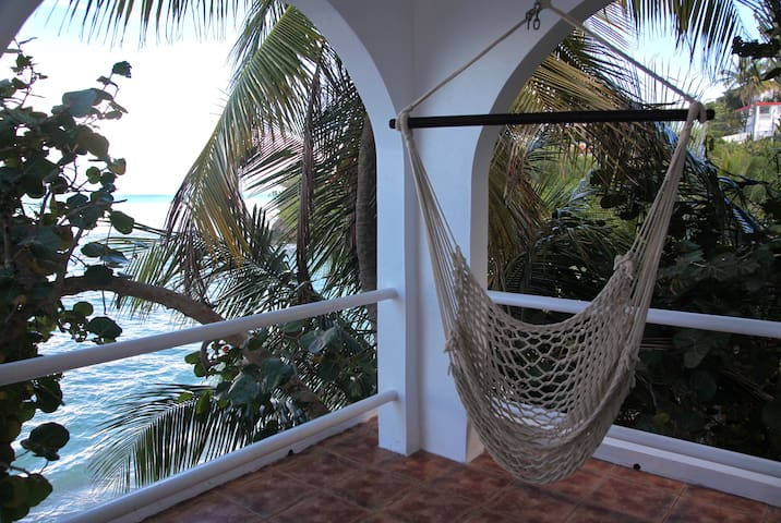 room 1: attached private balcony with hammock swing