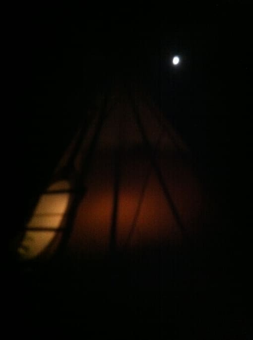 Tipi at night with the full moon