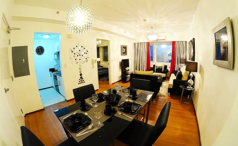 Great room with living area, dining area, and kitchenette