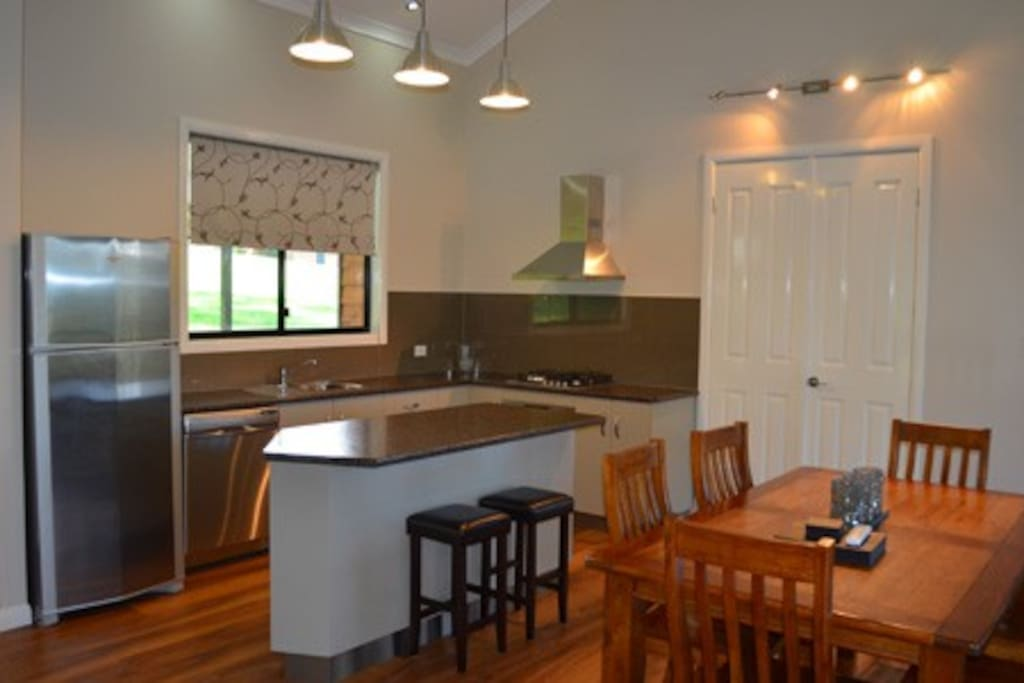 Very cosy kitchen allowing you to be involved with everything that is going on! Laundry behind closed doors as well.