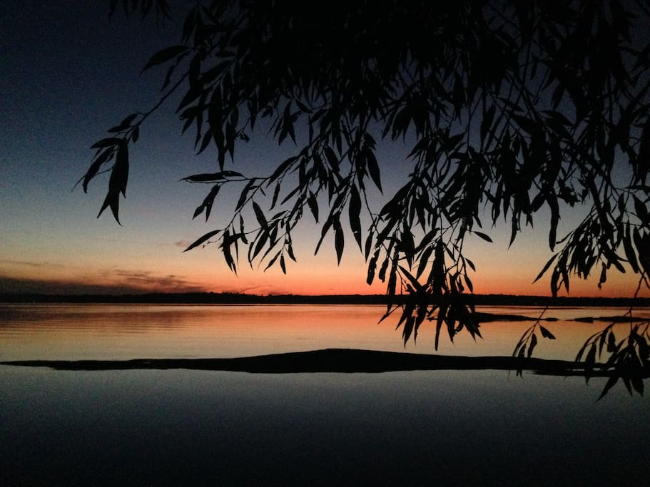 Facing west. Watch sunsets at night. Rock shoal protects waterfront from any boat traffic.