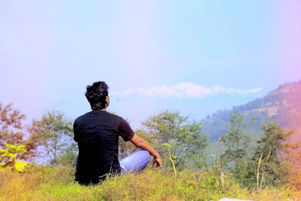 Yoga facing Kanchenjunga and Everest. Taken at our 360 Point