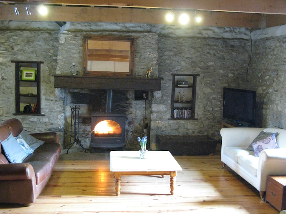 Large lounge with a welcoming log fire for cosy winter evenings