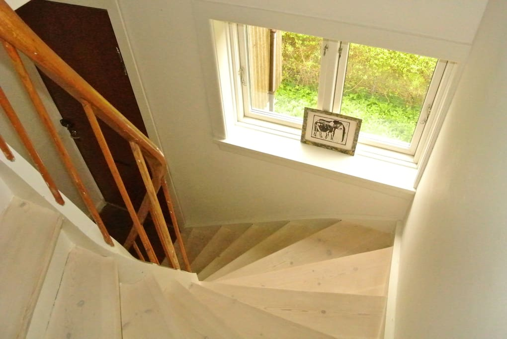 Staircase to three bedrooms on the top floor.