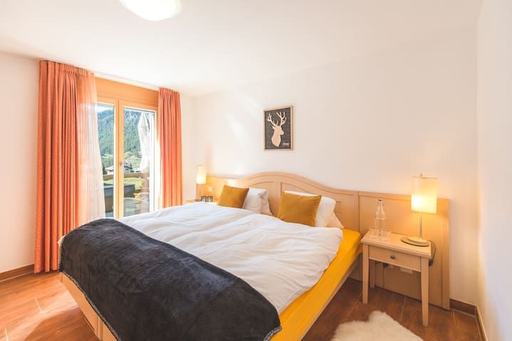 Cosy bedroom with Matterhorn view and access to south-facing sunny terrace.