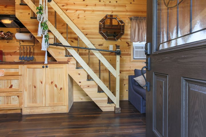 entrance into tiny home. please use rails for caution when going up to loft bedroom.