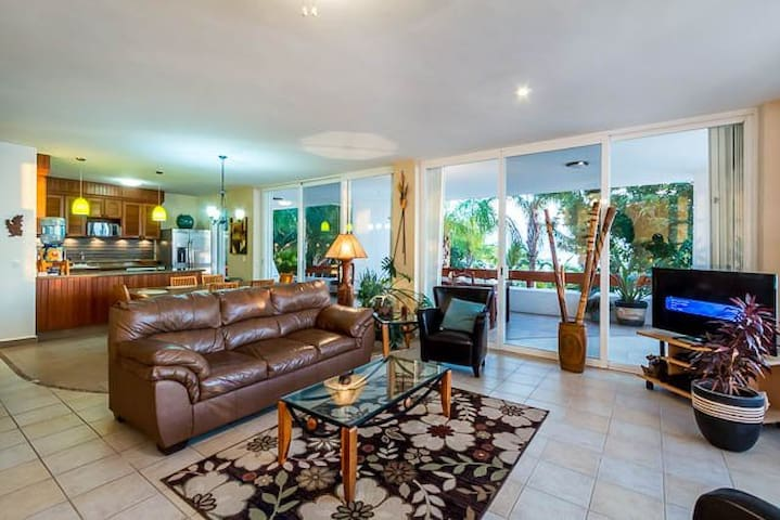The exquisite living room with exceptional views of the beach