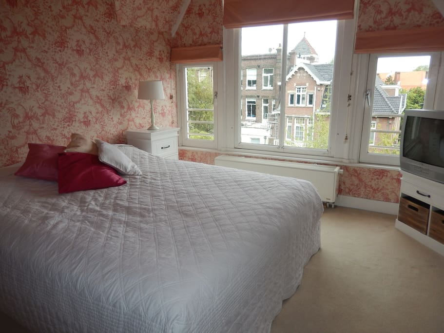 Toile de jouy wallpaper in spacious bedroom