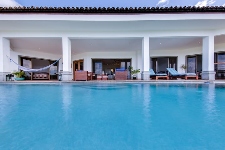 Step off our spacious terrace into the inviting infinity pool