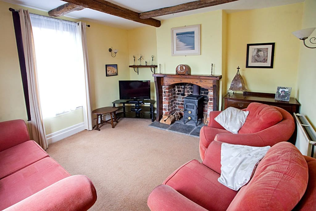 Lounge with original beams & log burning stove