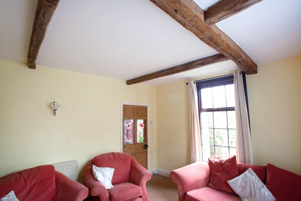 Lounge with original oak beams & feature pine doors