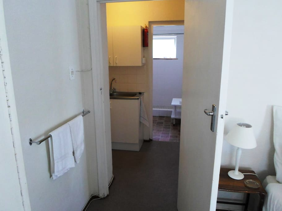 Looking towards the bathroom and kitchenette from the main bedroom. Those are hand towels. We do offer bath towels too!