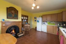 The big kitchen, with the new, hand-carved Celtic fireplace and Saltillo tile floor.