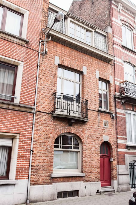 Typical Brussels house with red bricks.