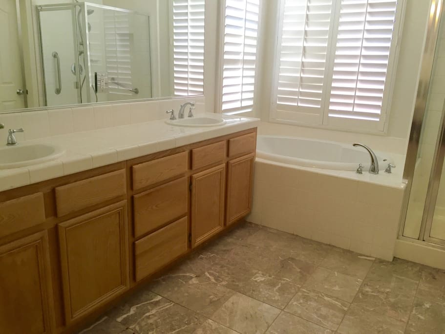 Master Bath with dual sink area, huge hot tub, and separate shower.