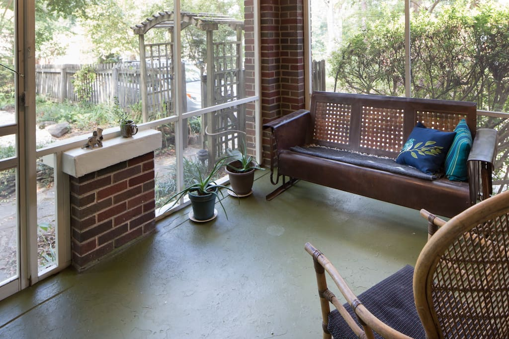 Relax on a vintage swing on the screened front porch.