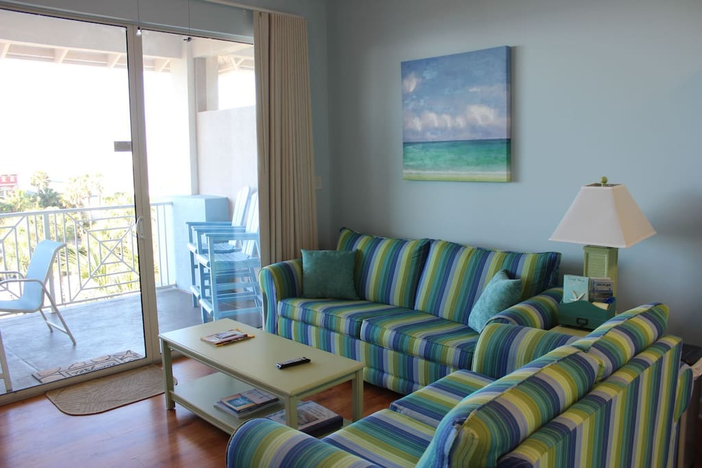 Living area with a clear view of the Gulf and Queen size sleeper sofa.