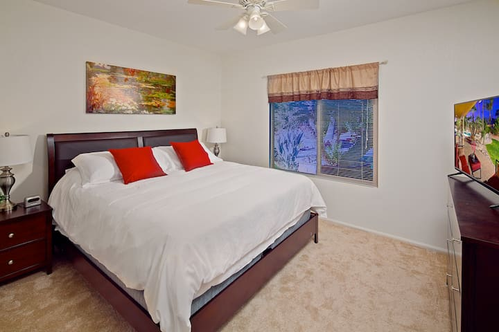 Bedroom 4: Comfy king bed, private TV, Located downstairs.