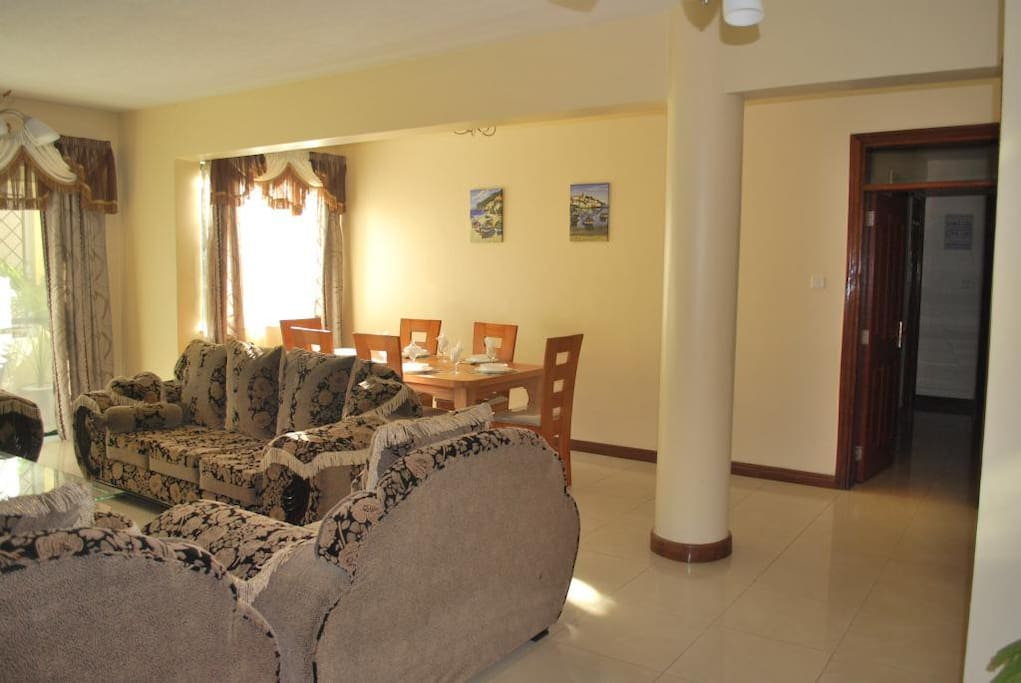 The lounge as you enter the apartment. Graciously spacious with a lot of room.