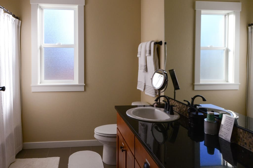 Full bathroom with shower, tub, and double sinks. Hospitality soaps, shampoos and toothpaste are available for your use. Guests have private use of bathroom.