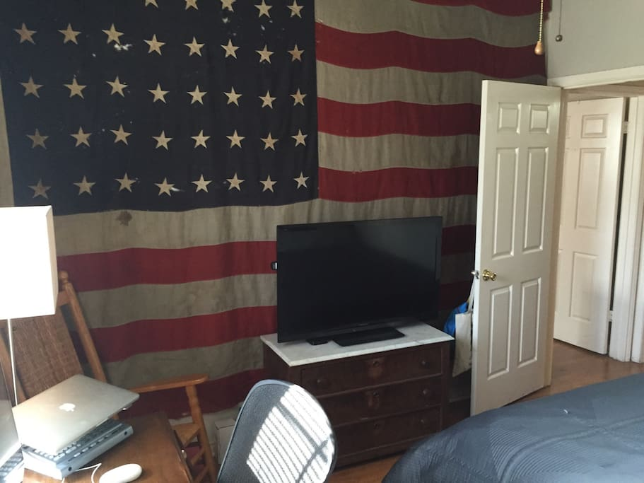 TV with AppleTV in bedroom