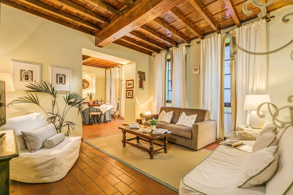 Beautiful Florence Apartment double living room with 1 double sofa bed, 1 single sofa bed and 1 single chair bed.