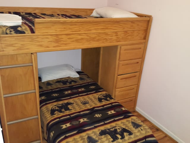 Guest room with twin over twin bunk beds.