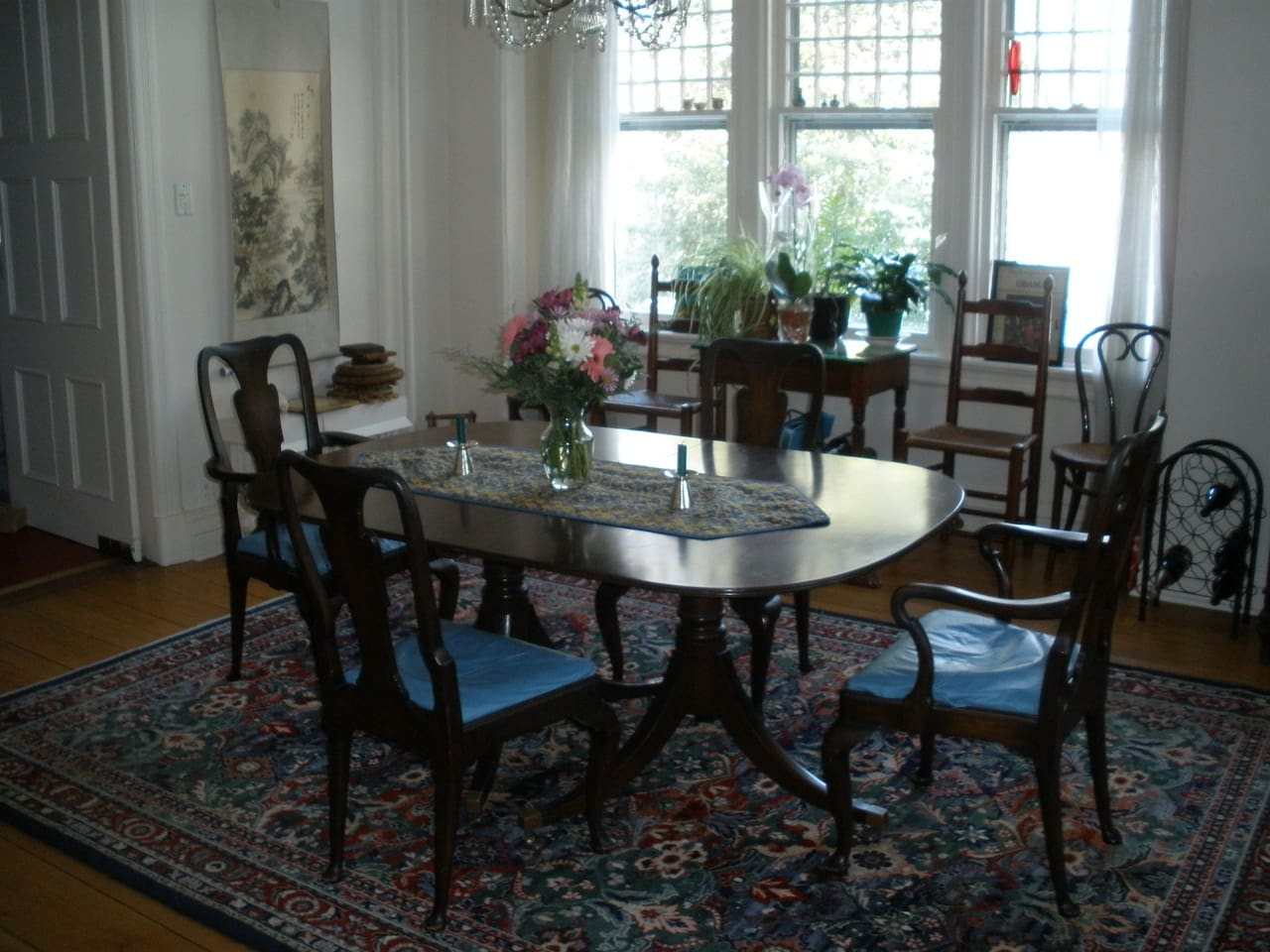 Dining room with many windows and generous space to seat six