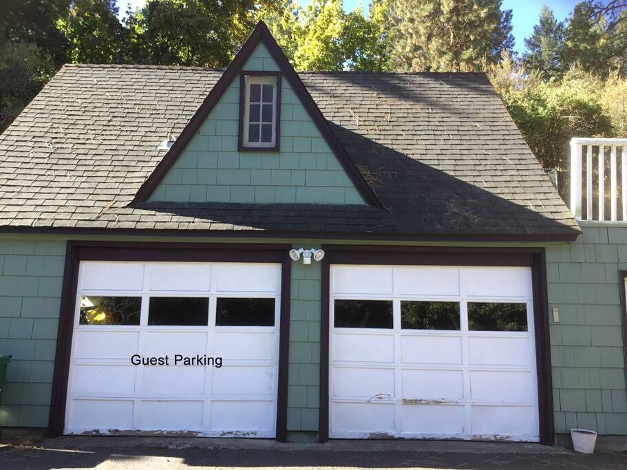 **Please park close up in front of the left garage door.**
