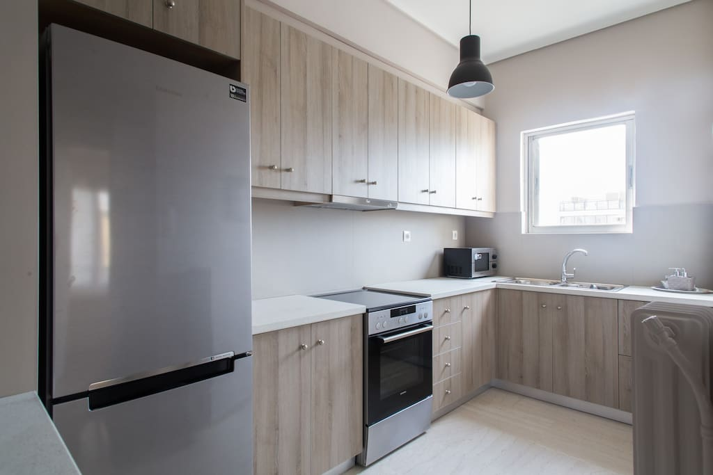 Modern kitchen fully equipped, (oven, microwave, refrigerator, kettle, toaster, coffee   filter machine) and dining area, the kitchen has a window, overlooking into the Acropolis.