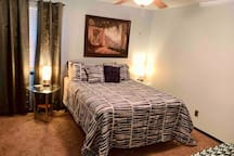 Large bedroom with queen size bed , 4 inch memory foam cool gel center and covered in a plush padded topper with a walk in closet. (there are nightstands on both sides of the bed with new lamps that have built-in phone charging USB ports )