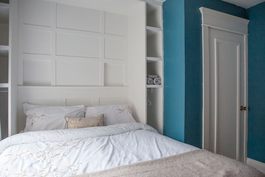 Custom built unit with room to hang clothes on both sides