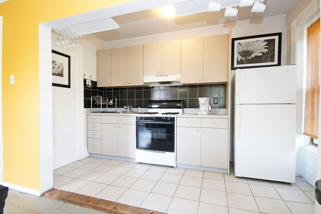 open kitchen, microwave, oven, coffeemaker and refrigerato