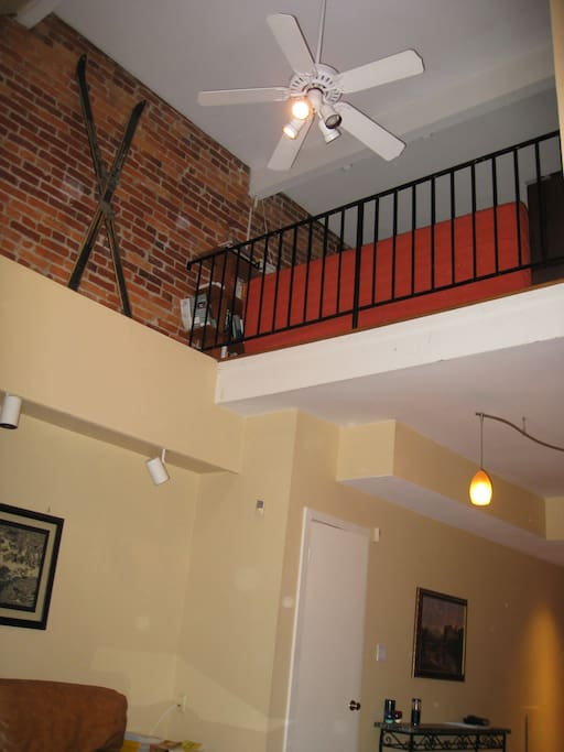 View of loft and vaulted ceilings in the living room.