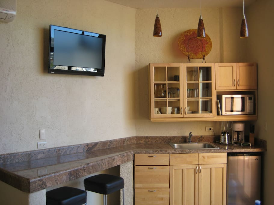 Kitchenette Area with seating.