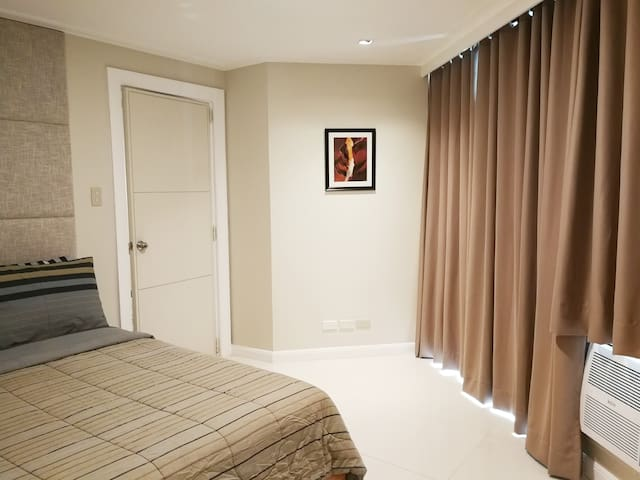 Masters Bedroom black out curtain giving you privacy and uninterrupted sleep