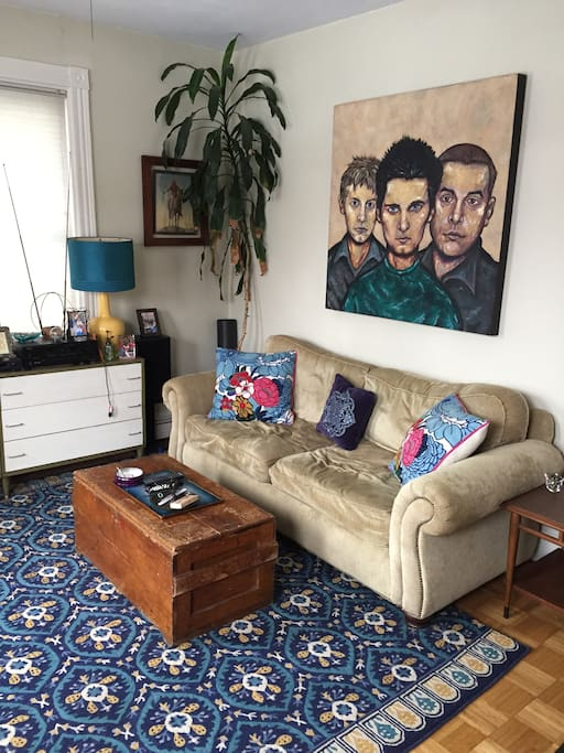 Comfy couch with local artist's painting...