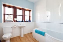 2nd floor bathroom, with shower over the bath and amazing views across the valley