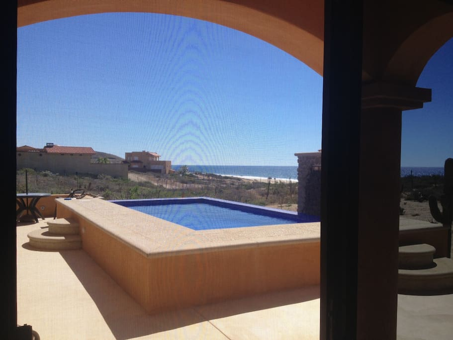 POOL DECK VIEW FROM GUESTROOM WITH SLIDING DOOR ACCESS