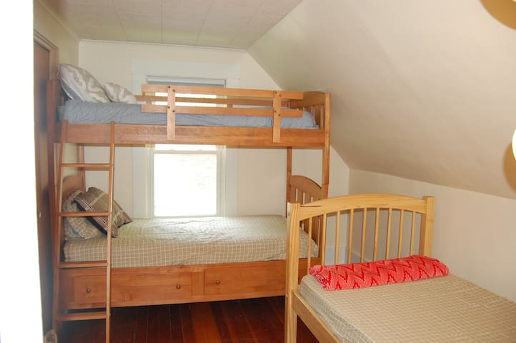 Bunk room with 3 single beds
