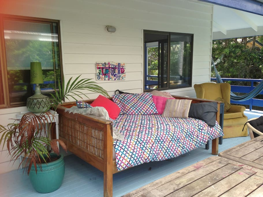 Day bed on balcony overlooking gorgeous garden!