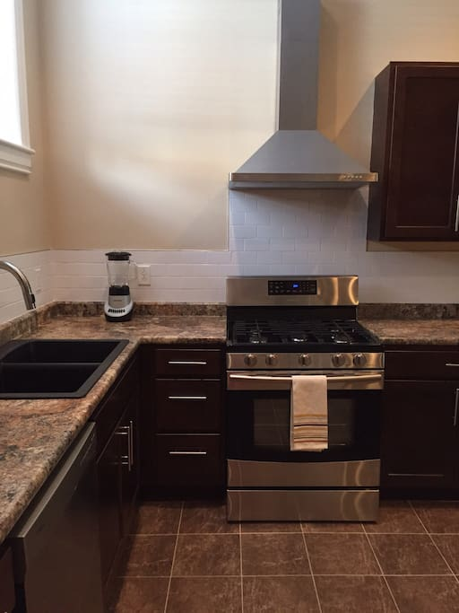 Large, double sinks, 5 burner gas stove with convection option oven, microwave, toaster and many other conveniences