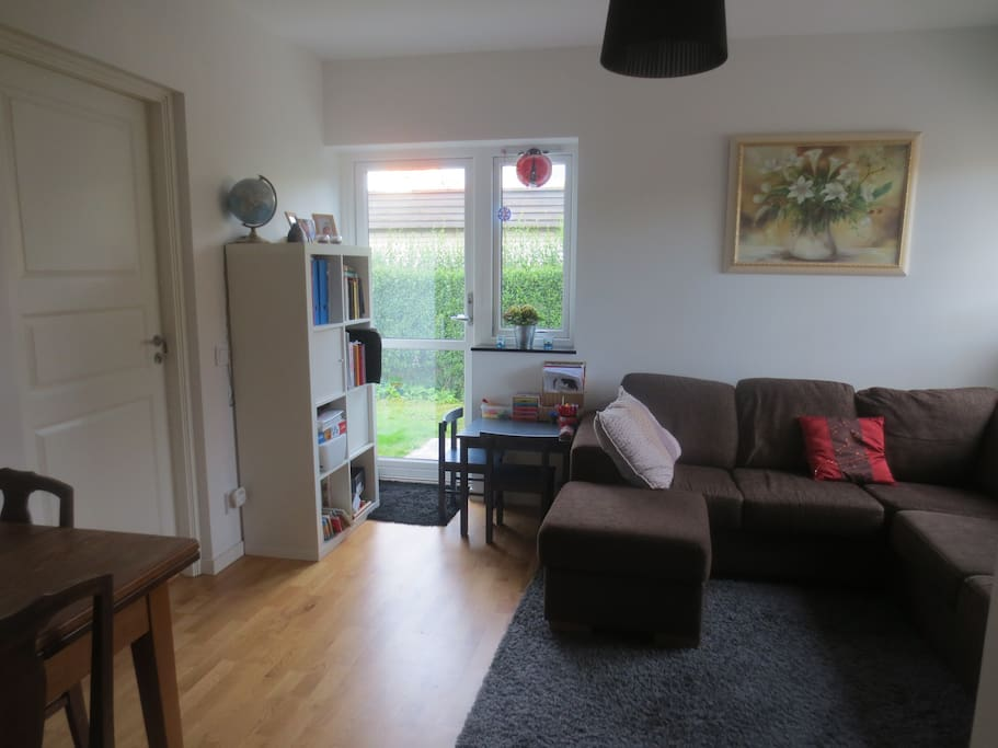 Bright living room with couch and dining table