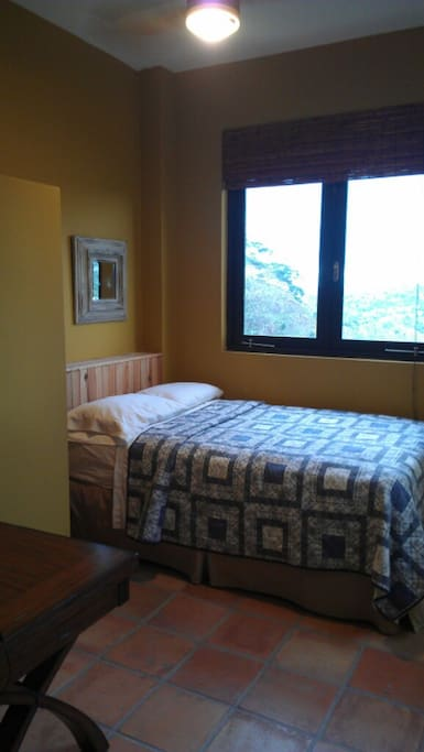 Bedroom with private shower  and views of Mount Atalaya