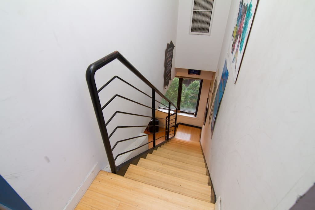 Stairs with art wall to upstairs Bedrooms, Bathroom, and Private Rooftop