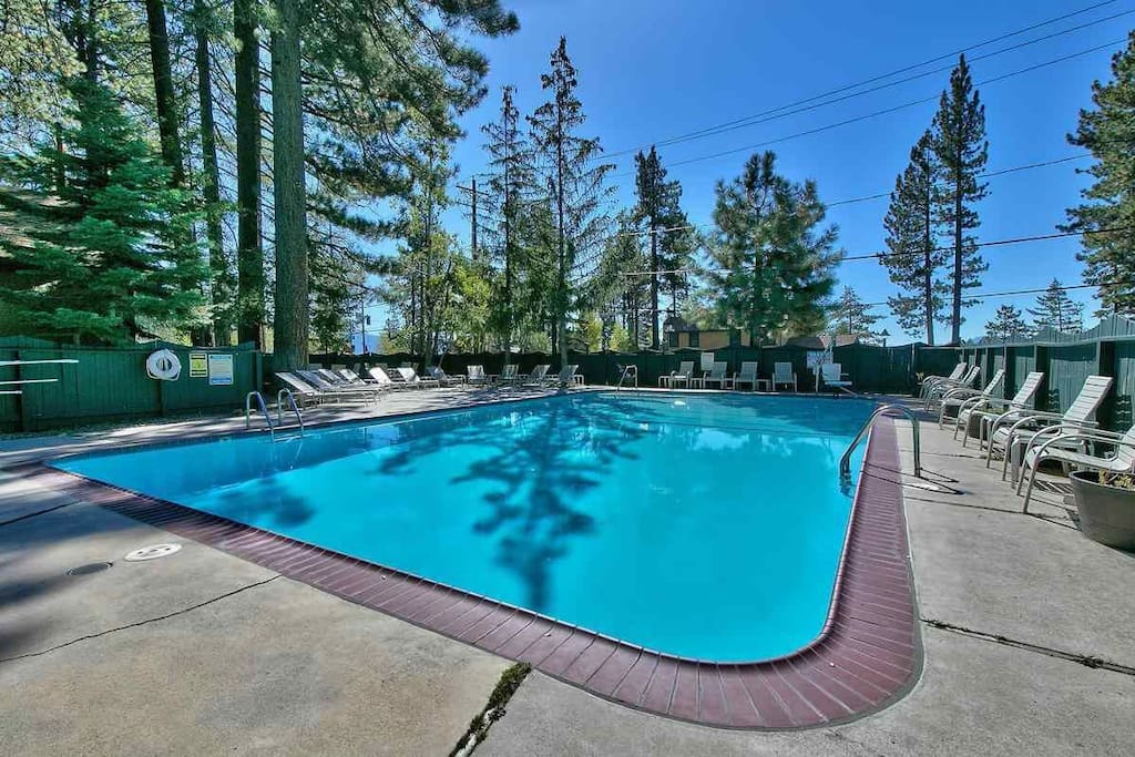 Heated pool on forest side, steps from apartment